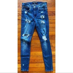 distressed, dark wash skinny jean
